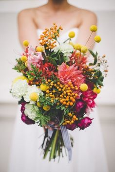 Bouquets For Every Type Of Wedding Billy Balls (or Craspedia) add the perfect amount of fun and spontaneity to any bouquet.Billy Balls (or Craspedia) add the perfect amount of fun and spontaneity to any bouquet. Seaside Wedding, Floral Wedding, Wedding Colors, Wildflower Wedding Bouquets, Rustic Wedding, Wild Flower Wedding, Wedding Table, Purple Wedding, Bright Wedding Flowers