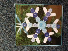 A cute snowflake ornament made with buttons and Popsicle sticks. #kindergarten #children #Christmas #kids