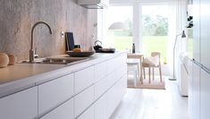 IKEA NODSTA A white kitchen with aligned doors, a white floor and a grey concrete wall Ikea New Kitchen, Ikea Metod Kitchen, Ikea Kitchen Design, Narrow Kitchen, Kitchen Interior, Kitchen Decor, Kitchen Living, Handleless Kitchen, Kitchen Layouts