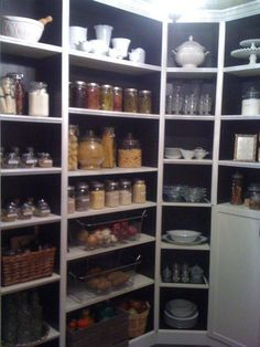 """I came across a site called Ikea hackers. This site changed everything! I could actually have my dream pantry! All it would take is some measuring and some """"hacking"""" of Ikea's billy shelving. This is the result of standard billy shelving, paint, and some trim work."""