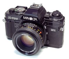 """Minolya Maxxum 7000 SLR    I was actually kind of disappointed when I received this """"used"""" camera as a Christmas gift instead of the cute, hip and decidedly less intimidating Diana camera I so longed for.   But now I'm like """"Diana who?"""""""