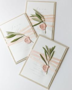 Letterpress Save the Date affixed to a natural linen board with an onion skin overlay wrapped with champagne silk ribbon and secured with a blush wax seal and an olive branch snipped from the venue in Napa. Design by YONDER DESIGN.