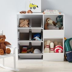Combining practical details with classic good looks, the Addison Toy Storage System can help restore order to playrooms and kids' rooms. Its shelved design includes five removable plastic bins - four small and one large. Use them to sort games, books and action figures, or to carry toys from room to room. When it's time to clean up, each bin fits back on its shelf so contents are always organized and out of the way.