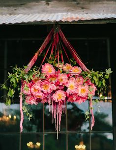 Hanging peonies over the ceremony space.