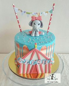 Circus dripping cake with cute girly elephant figurine