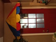 Door canopy for VBS  Made with plastic table cloths, heavy paper for sturdiness, hula hoop and wire on ends and center with a loop on top to hang. This requires sewing. All materials from dollar store cost $5.00.