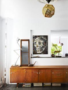 midcentury modern sideboard + geometric pendant light