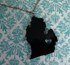 Michigan pendant with heart cutout in shrink plastic.