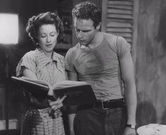 "onlybrando: "" Marlon Brando as Stanley kowalski between takes with Polly Craus (script clerk) while filming ""A Streetcar Named Desire"" Circa 1951. """