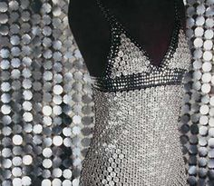 created by Paco Rabanne in 1970, hundreds of metal flat buttons
