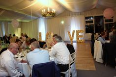 Wedding guests enjoying the ambiance of the flower wall LOVE light up letters Light Up Letters, Function Room, Greggs, Love And Light, Flower Wall, Wedding Venues, House, Wedding Reception Venues, Illuminated Letters