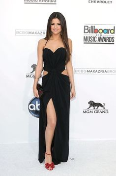 Selena Gomez in a black cutout dress with red heels at the Billboard Music Awards