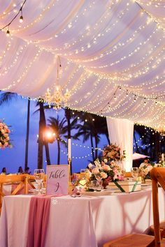 Elegant outdoor wedding tent reception with ceiling draping and LED string lights for magical wedding lighting using CV Linens string light curtains, ceiling draping, tablecloths, and table runners! Perfect dusty rose wedding decorations for spring and summer outdoor wedding reception parties. Wedding tent lighting and wedding tent decorations are DIY with our budget friendly wedding decorations. #weddingtentdecorations #weddingtentlighting #weddingtentideas… Wedding Tent Lighting, Wedding Tent Decorations, Wedding Reception Tables, Tent Reception, Ceiling Draping, Wedding Colors, Wedding Ideas, Dusty Rose Wedding, Dusty Rose Color