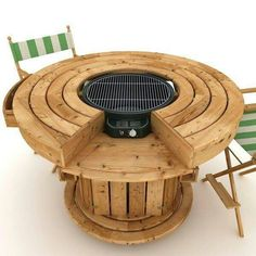 Round Barbeqie and Firepit with table made out of Pallets and other wood.