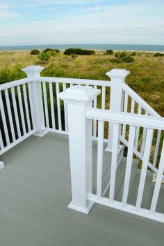 Add safety and design to your home with AZEK Reserve Rail. This generously sized railing will beautifully transform your AZEK Deck or AZEK Porch offering both function and style. In classic white, AZEK Reserve Rail's upscale looks provide premium looks and outstanding durability. Use our AZEK design tools to create a railing to fit for your home and style.