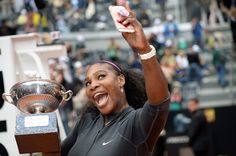 US Serena Williams takes a selfie with the trophy after winning the final match of the WTA Tennis Open tournament game against US Madison Keys at the Foro Italico in Rome on May 15, 2016.     / AFP / FILIPPO MONTEFORTE