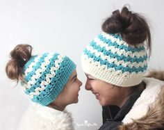 The latest crochet trend: Messy Bun Hats! Also known as pony tail hat, these beanies have a hole at the top for your hair to hang through. A fun and functional look! I've created a quick and easy version using the cluster v-stitch. The pattern comes in child & adult