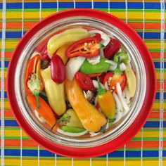 Pound of Pickled Peppers: Ingredients include both sweet and hot peppers (such as banana, fresno and jalapeno), an onion, cider vinegar, water, sugar, salt, bay leaf, coriander, cumin seeds, dried oregano, garlic cloves and black peppercorns. ~ by Sippity Sup.