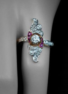 7 Calibre Cut Rings That Will Leave You Breathless: Calibre Cut Ruby and Diamond Wing Ring