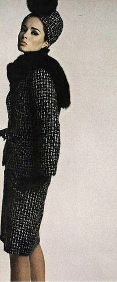 1962 Sondra Peterson in black and white tweed suit with longer jacket and mink pom-pom hat by (Marc Bohan)
