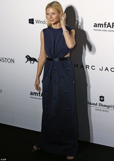Peek-a-boo! Gwyneth Paltrow flashes a hint of flesh in floor-length navy gown at amfAR gal...