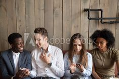 Millennial multiracial friends using phones talking at meeting, diverse young people spending time together with smartphones in cafe, serious and happy multiethnic mobile addicts obsessed with cells Young People, Addiction, Phones, Smartphone, Stock Photos, Couple Photos, Friends, Happy, Image