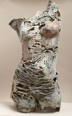 """Pearl"" figure sculpture by Pauline Lee. Paperclay textured and pierced female torso. Applications of stains and oxides and fired to 2200 degrees C."
