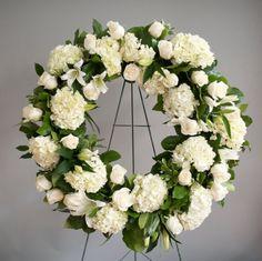 White roses, carnations, and stargazer.