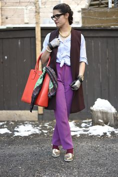 Image of Kayla showing us how to wear colours in winter, malorie urbanovitch fuchsia pants, burgundy vest, tailored shirt, gold shoes, street style, read more about it at the neat blog