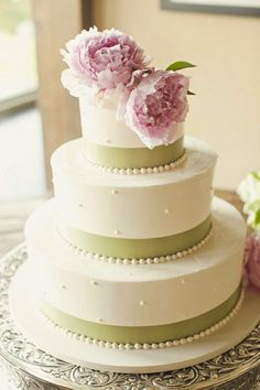 Peonies on wedding cake.
