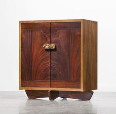 George Nakashima; Persian Walnut, American Black Walnut, East Indian Rosewood and Burl 'Kornblut' Cabinet, 1984.