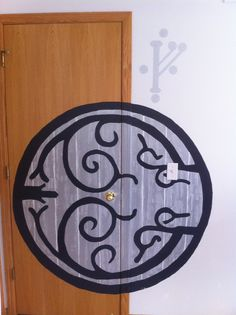 Our Lord of the Rings Nursery. I made this Hobbit Hole door using a transparency on an old fashioned projector to trace the image. I used various layers of paint and a wood graining tool like this one http://www.amazon.com/gp/aw/d/B000BZZ1WQ  Pregnant and considering adoption or know someone who is? Help us fulfill our dream of becoming parents! Please visit our page or website: www.facebook.com/babyadoptus  www.babyadoptus.com