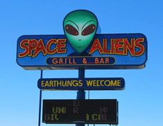 Space Aliens grill and bar in Fargo, North Dakota. The lower signboard flashes subliminal messages in the language of the superior culture in an effort to sell more appetizers and desserts to unsuspecting Earthlings.