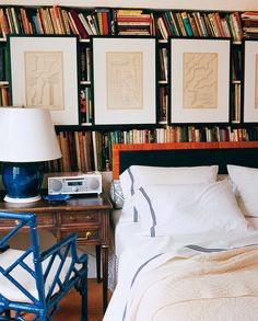 How smart! Hanging artwork from your shelves is the perfect way to display your favorite pieces when you don't have much wall space. Plus, it adds dimension to any room and hides books that may be ripping apart.  Source: Domino