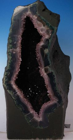 """. Weighs 83.64 lbs and measures 19"""" tall x 10"""" wide x 9 1/2"""" deep. Excellent agate rind and super dark amethyst crystals. This geode is DEEP!   Www.cathedralgeodes.com"""