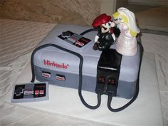 Nintendo Cake : Super Mario and the Princess as a topper - Betty Jane's Bakeshoppe---also like the idea of a Wii and mariokart wedding figures