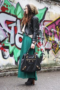 An admirable mix of street / grunge elements (leather, slouchy knits, beanie) with elegant pieces (minty green maxi, tights, heels).