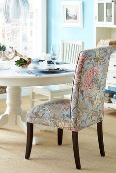 Picnic in a field of flowers in the comfort of your own dining room with Pier 1's Angela Deluxe Dining Chair in soft, floral pastels.