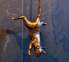 Beautiful original bronze cat portrait of Augie with swinging mouse in his mouth, designed for use as door knocker or wall sculpture. These were created by artist Derek Bernstein and executed in traditional lost wax bronze casting. Each piece is unique and is signed and numbered. The sculpture is life-size (cat head roughly 4-5 each way). Can be easily mounted on a front door using brass screws, which we will provide, or on a board for wall mounting.