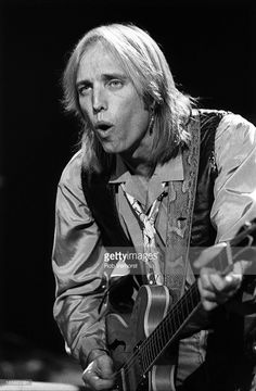 Tom Petty performs on stage with Bob Dylan at Ahoy, Rotterdam, Netherlands, 19th September 1987. Photo by Rob Verhorst
