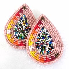 These sparkling earrings were made by Chenoa Williams (Pyramid Lake Paiute). They feature a pyramid pattern within a teardrop shape using tiny spar...