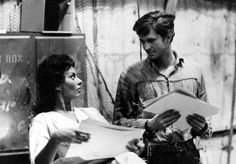 Sophia Loren and Anthony Perkins look at stills between shots of Desire Under the Elms (1958)