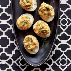 Sriracha-and-Wasabi Deviled Eggs | Joanne Chang's mother used to make hard-boiled eggs for dinner: She would add them to the beef or chicken she was braising in soy. This is Joanne's riff on those eggs, made spicy with hot sauce and wasabi.