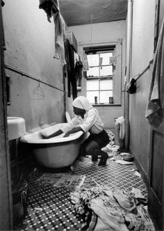 © The Gordon Parks Foundation Rosie Fontenelle Cleans the Bathtub, Harlem, New York, 1967.