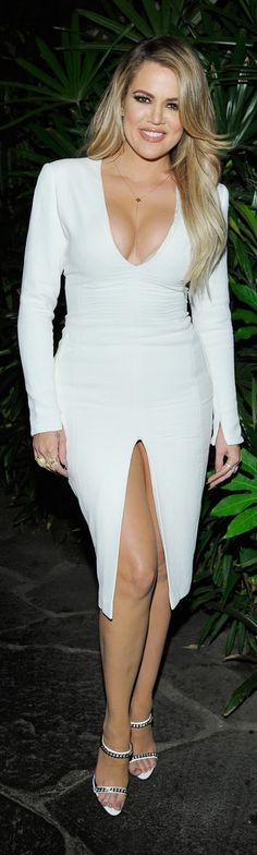 Khloe Kardashian stuck to the Easter theme and rocked a long-sleeve bodycon mini dress with a plunging neckline and a superhigh leg slit. She added a dainty chain necklace, then turned up the edge with chunky gold rings and embellished white sandals at the #MyCalvins denim campaign launch party.