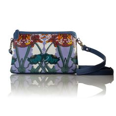 COMING SOON A flower moment (Rectangle) Cross-body leather handbag  INSPIRATION  This print is an explosion of printed feathers. Followed by a flock of birds trying to break through to this world.    INFORMATION  Rectangular soft shoulder bag. All leather, with leather trim in soft orange calf skin leather. Detachable and adjustable cross strap for easy wear.  SIZE  Height: 16cmcm  Width: 26cm  Strap: 114cm  Depth 3cm  www.lisaryderdesigns.ie