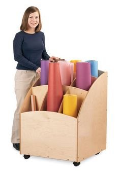 The Jonti-Craft Paper Roll Bin features 9 large slots, and is easy to move around for multiple rooms.
