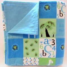 Baby boy blue Little Buddy design baby blanket. Solid blue flannel on reverse side. Crafted from soft cotton snuggle flannel. Double sided and reversible. Warm and soft. Measures 38 X 39 inches. Larger than a receiving blanket, this blanket can be used in a car carrier, stroller, for tummy time and much more. Top stitched with a decorative effect and to increase durability of the fabric. Fabrics have been pre and post washed in a hypoallergenic product. Machine wash warm. Tumble dry, low…