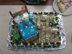 My boys' birthday cake...Toy Story theme...used McD's type toys.  Made bed out of cake/pretzels/graham crackers.  Army men lined the cake.  Huge hit!!