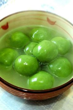 """Chè bánh xếp - green bean wrapped in a tapioca skin dumpling eaten in a coconut milk base with smaller pieces of tapioca. Translated to English, the dish is """"folded cake dessert""""."""